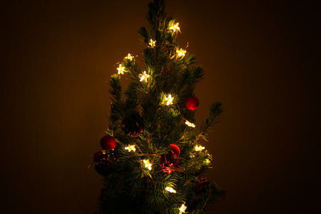 stock photo tiny cute christmas tree with small lit stars - Small Lit Christmas Tree