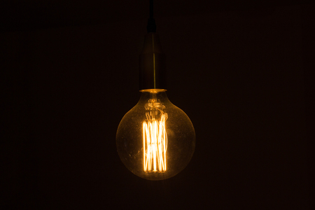 Big lightbulb hanging from ceiling turned on stock photo picture big lightbulb hanging from ceiling turned on stock photo 51898033 aloadofball Image collections