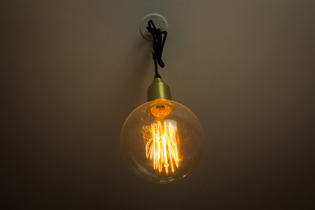 turned: Big lightbulb hanging from ceiling turned on