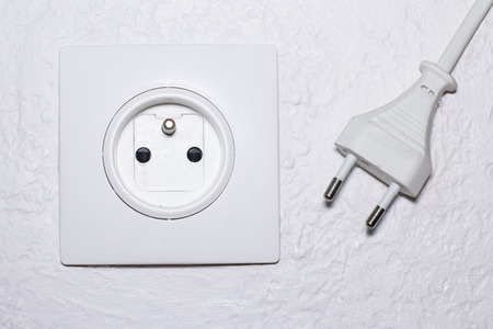 wall socket: White wall socket and electrical plug Stock Photo