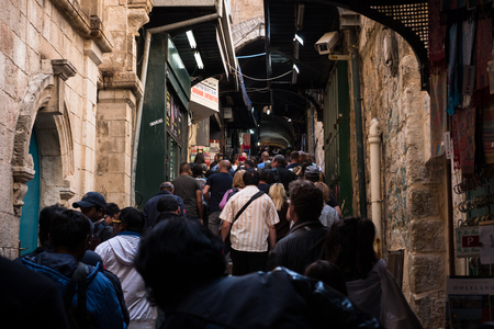 Jerusalem, Israel - March 17th, 2018: People walk the Via Dolorosa in the Old City of Jerusalem, Israel.