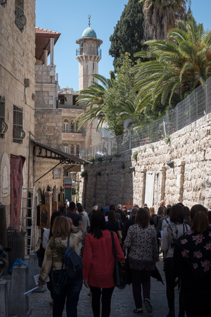 Jerusalem, Israel - March 17th, 2018: People walk the streets of the Old City of Jerusalem, Israel. Editorial