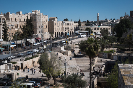 Jerusalem, Israel - March 17th, 2018: People walk the street in front of the Damascus Gate, in the Old City of Jerusalem, Israel.