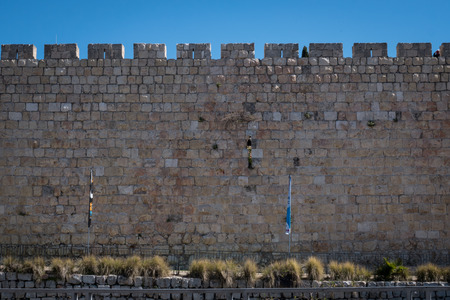 The wall of Jerusalems Old City under blue sky