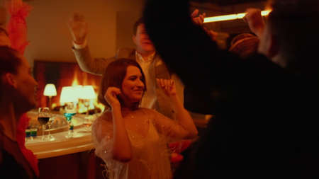 Happy friends dancing on party in luxury restaurant. Emotional people having fun in bar. Excited group of people making moves in rhythm at nightclub in slow motion. Joyful friends celebrating birthday Banco de Imagens - 158348557