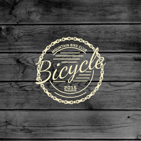 cycling mountain: Bicycle badges logos and labels for any use, on wooden background texture