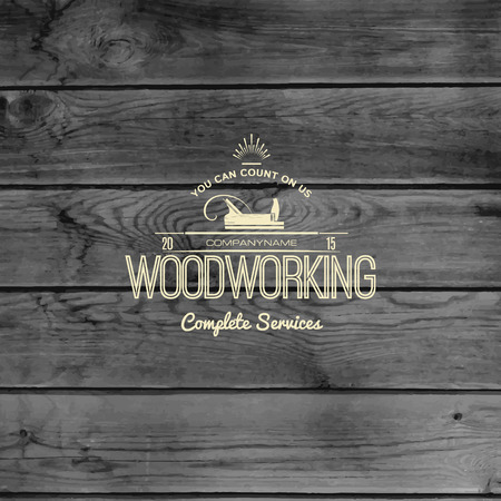 Woodworking badge and label for any use, on wooden background texture