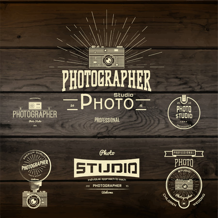Photography badges and labels for any use, On wooden background texture  イラスト・ベクター素材