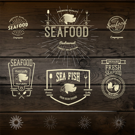 seafood: Seafood badges  and labels for any use. On wooden background texture Stock Photo