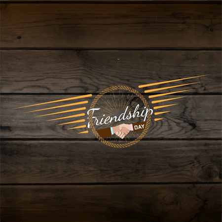 eg: Friendship day badges   labels for any use, eg for design of cards or presentations, on wooden background texture