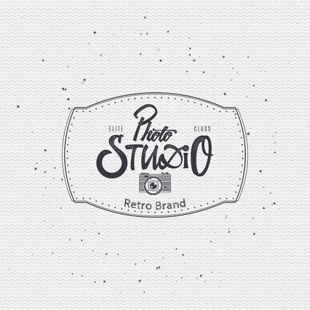 worn paper: Photo studio badge insignia, monochrome using geometric shapes assembled in typographic elements on textured background worn paper Illustration
