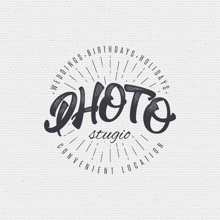 assembled: Photo studio badge insignia, monochrome using geometric shapes assembled in typographic elements on textured background worn paper Illustration
