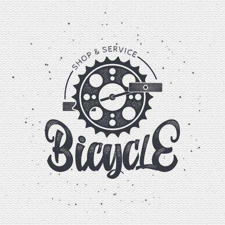 worn paper: Bicycle badge insignia, monochrome using geometric shapes assembled in typographic elements on textured background worn paper Stock Photo