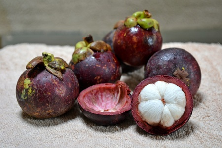 pics: Mangosteen fruit ; The fruit of mangosteen is sweet and tangy,juicy,somewhat fibrous.