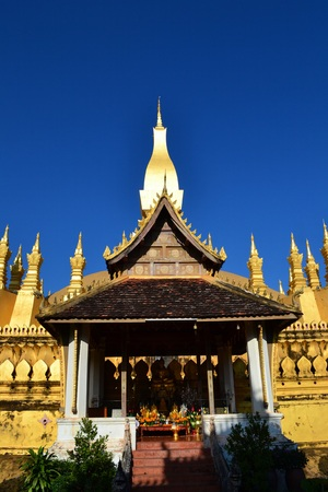 translates: Phra That Luang.Vientiane,Laos.That Luang is officially name Phra Chedi Lokajulamani,which translates to World Precious Sacred Stupa Stock Photo