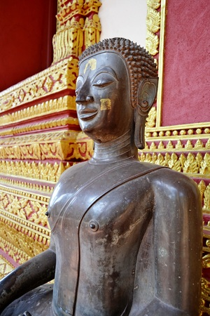 verandas: Seated Buddha image at verandas of Haw Phra Kaew Temple.Vientiane.Laos