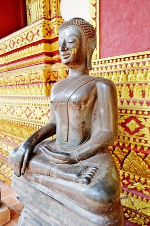 subduing: The attitude of Subduing Mara : Seated Buddha image at verandas of Haw Phra Kaew Temple.Vientiane.Laos Stock Photo