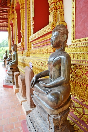 verandas: The attitude of Subduing Mara : Seated Buddha image at verandas of Haw Phra Kaew Temple.Vientiane.Laos Stock Photo