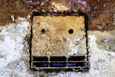 cement sewer lid background photo