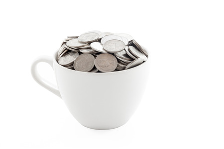White cup filled with coins