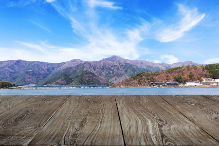 wooden floor with lake and mountain background