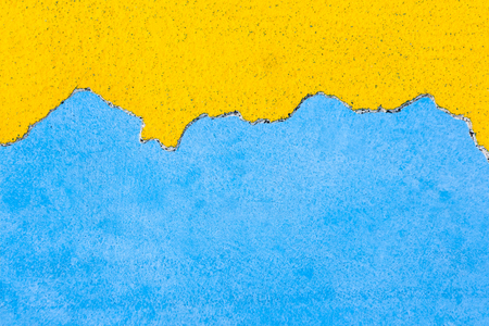 Grunge cement wall color blue and  yellow used as background