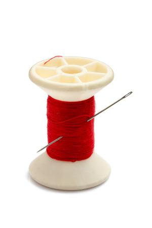 Spool of thread and needle