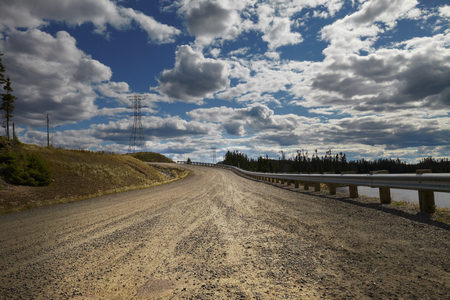 guard rail: Desert road with cloudy sky in Canada Stock Photo