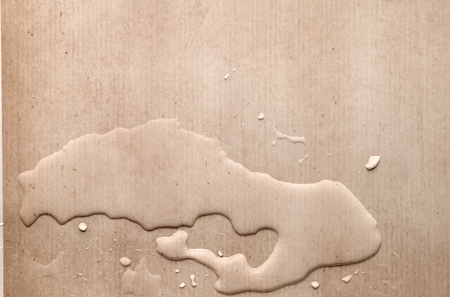 abstracted: splash drops on carton piece of paper Stock Photo