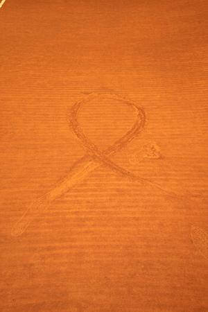 desert footprint: stripe an footprints on red sand courts Stock Photo