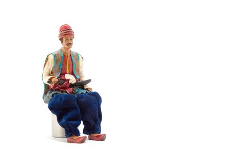 Puppet sitting on a white background photo