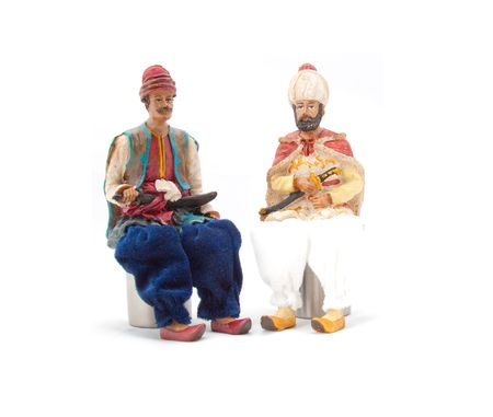 Puppets sitting on a white background photo