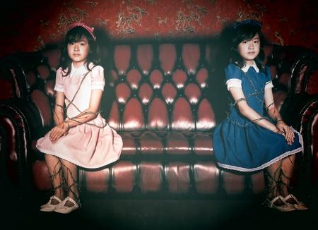artwork: Twin girl on sofa
