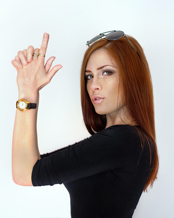 foxy girls: Girl with gun fingers Stock Photo