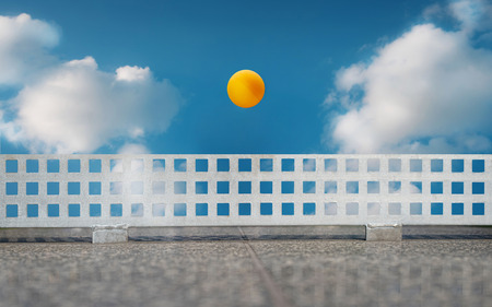 clouding: Table tennis ball fly on the clouding sky background