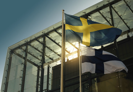 finland: flags of Sweden and Finland Stock Photo