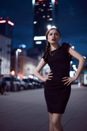 lifestyle shopping: Sexy young beauty fashionable woman posing over night city background Stock Photo