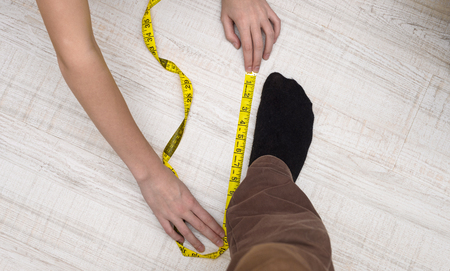 girl measures the size of your male legs