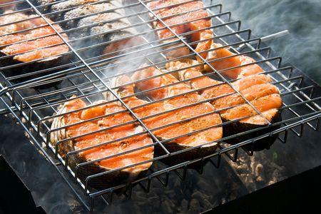 fresh fish on grilling sticks