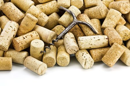 brown cork: Old corkscrew on a heap of wine stoppers from bottles Stock Photo