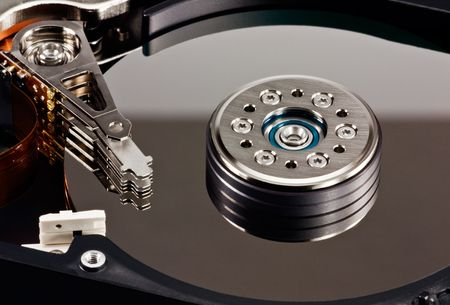 A close up of an opened computer hard disk drive photo