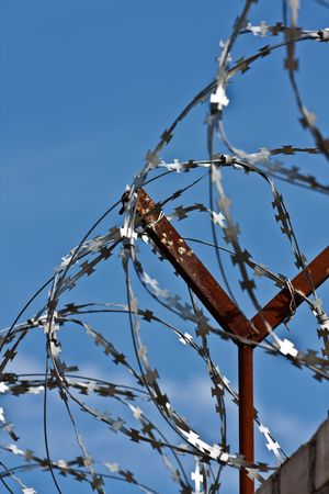 A barbed wire fence with razor sharp wires photo