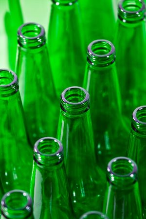 Empty green bottles in a row photo