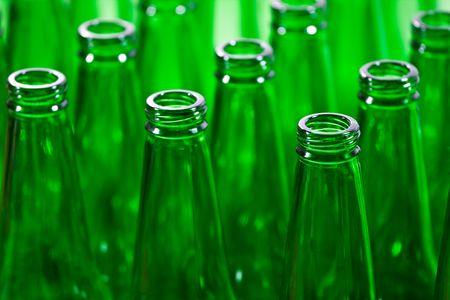 Empty green bottles in a row