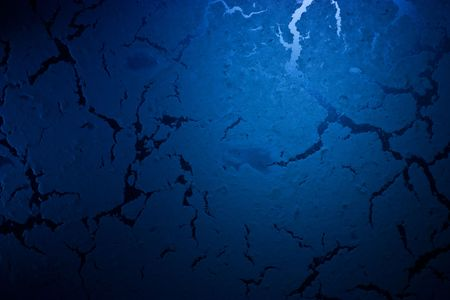 Abstract dark blue grunge textured surface background  Stock Photo