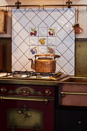 Interior of old kitchen with a copper kettle on stove photo