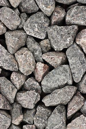 Texture of crashed grey granite gravel background photo
