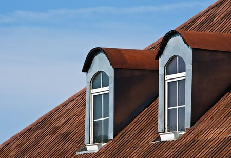 Dormer windows and red tiled metal rooftop photo