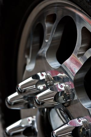 Automobile wheel with the chromeplated disk closeup Stock Photo - 5621543