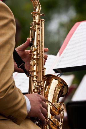 The jazz musician plays on a saxophone Stock Photo
